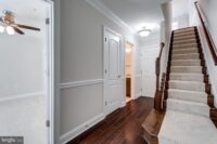 403 N Upton Ct. Arlington VA 22207 entrance foyer with glass door to living room and starway to upper levels